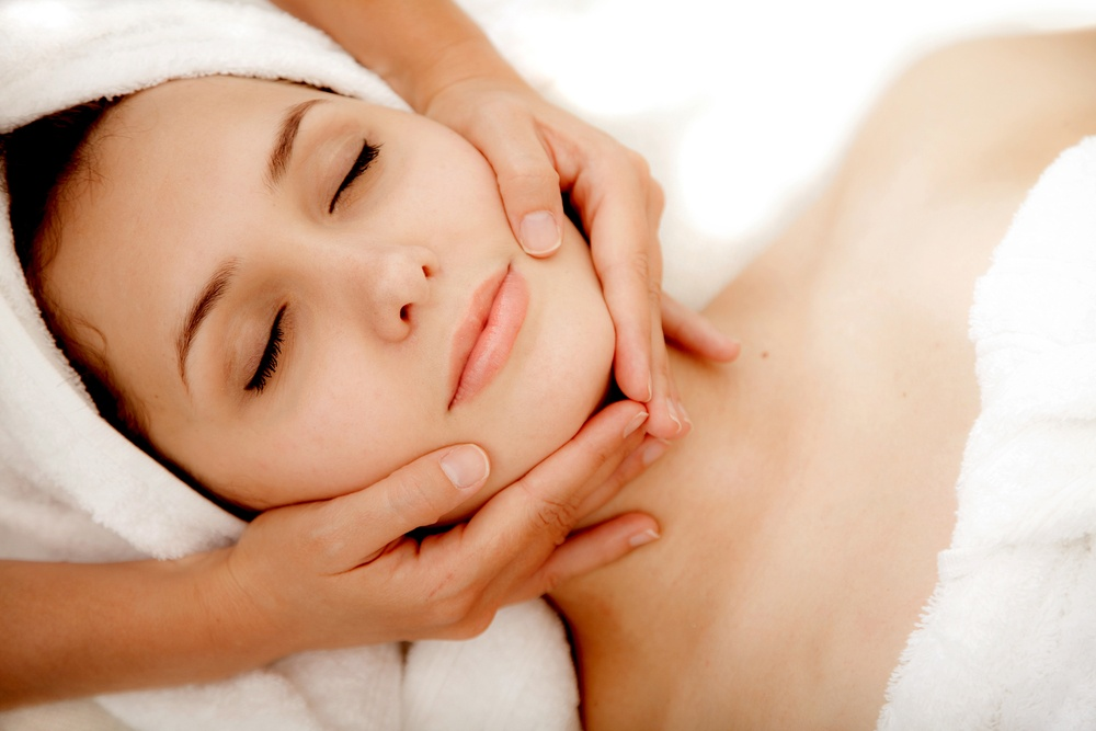 Woman at a spa getting a massage in her face.jpeg