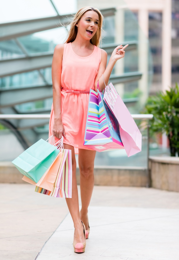 Shopping woman at the mall holding bags.jpeg