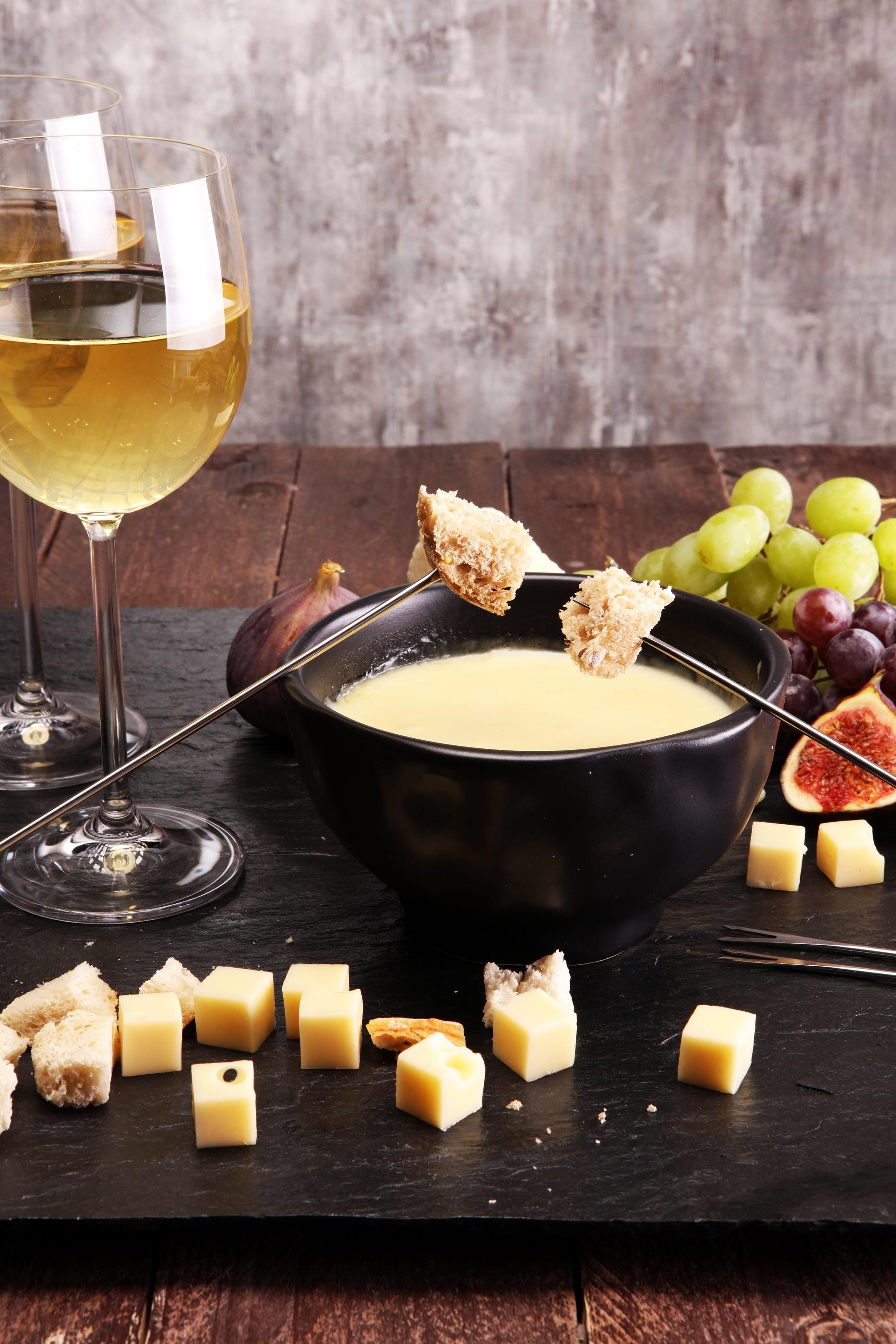 bigstock-Gourmet-Swiss-Fondue-Dinner-On-205357309.jpg