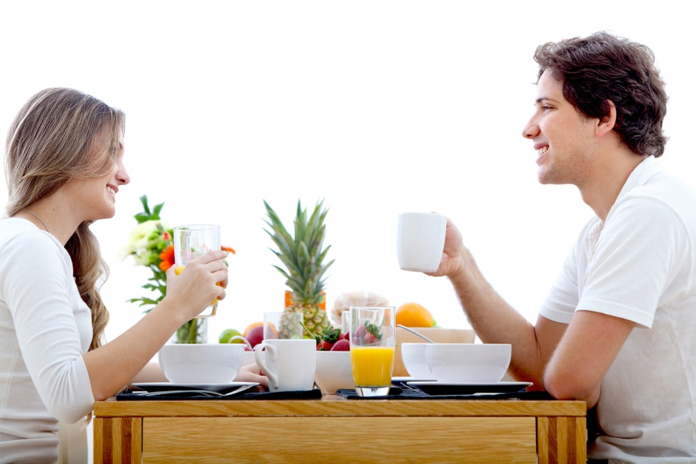 Beautiful couple eating their breakfast at home.jpeg