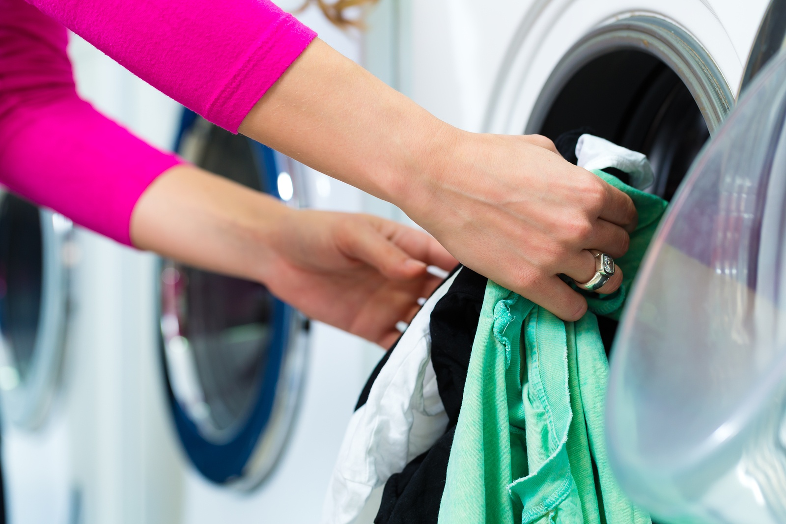 bigstock-Young-woman-in-a-launderette--51267334.jpg