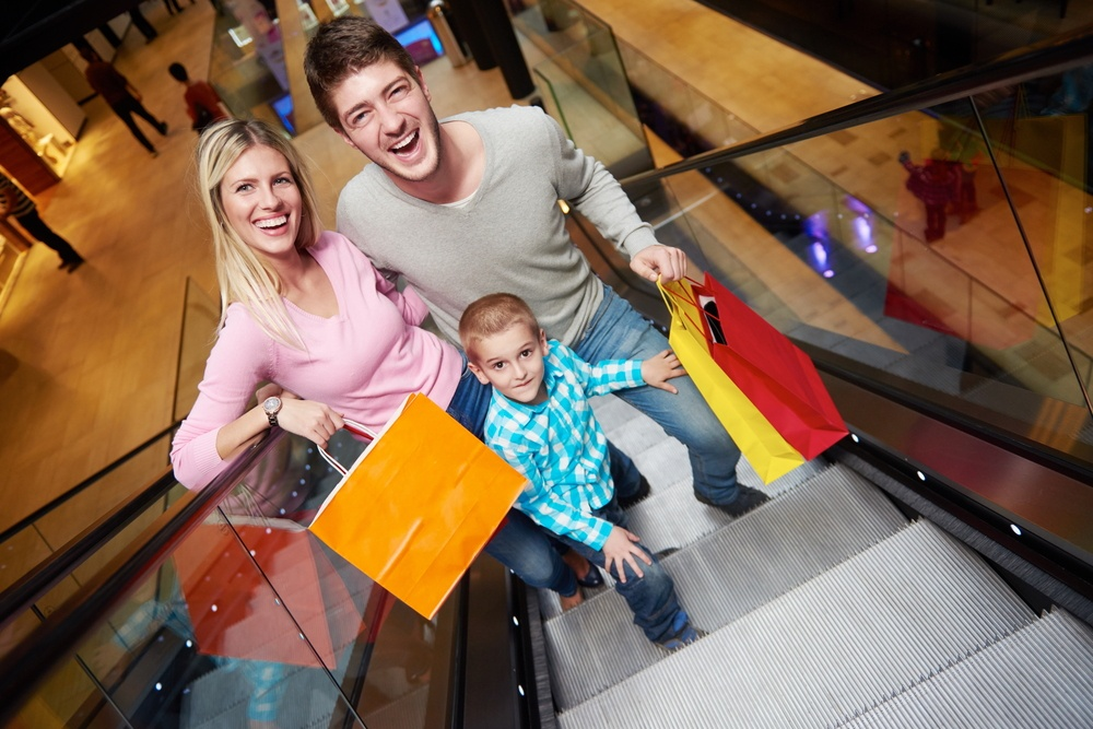 happy young family portrait in shopping mall.jpeg