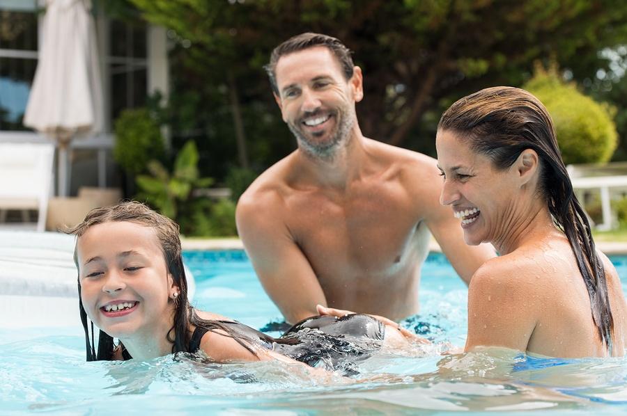 bigstock-Happy-parents-teaching-their-d-129582605.jpg