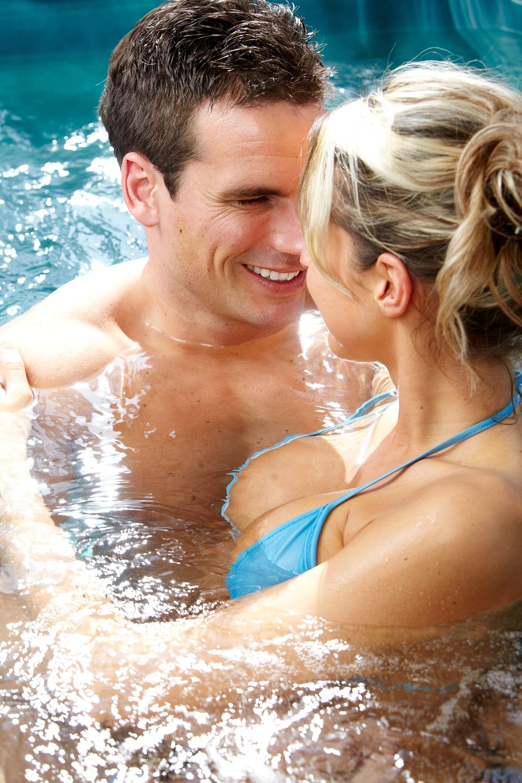 bigstock-Young-couple-relaxing-in-hot-t-88606304.jpg