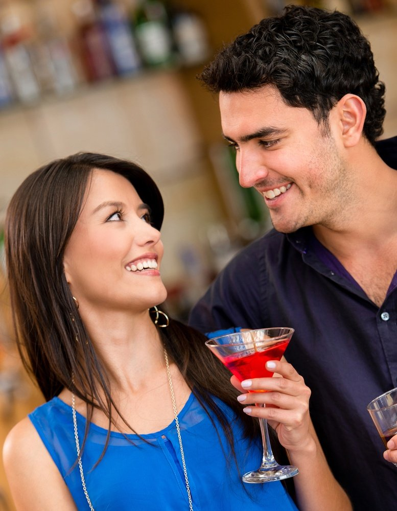 Couple having a drink at the bar and smiling.jpeg