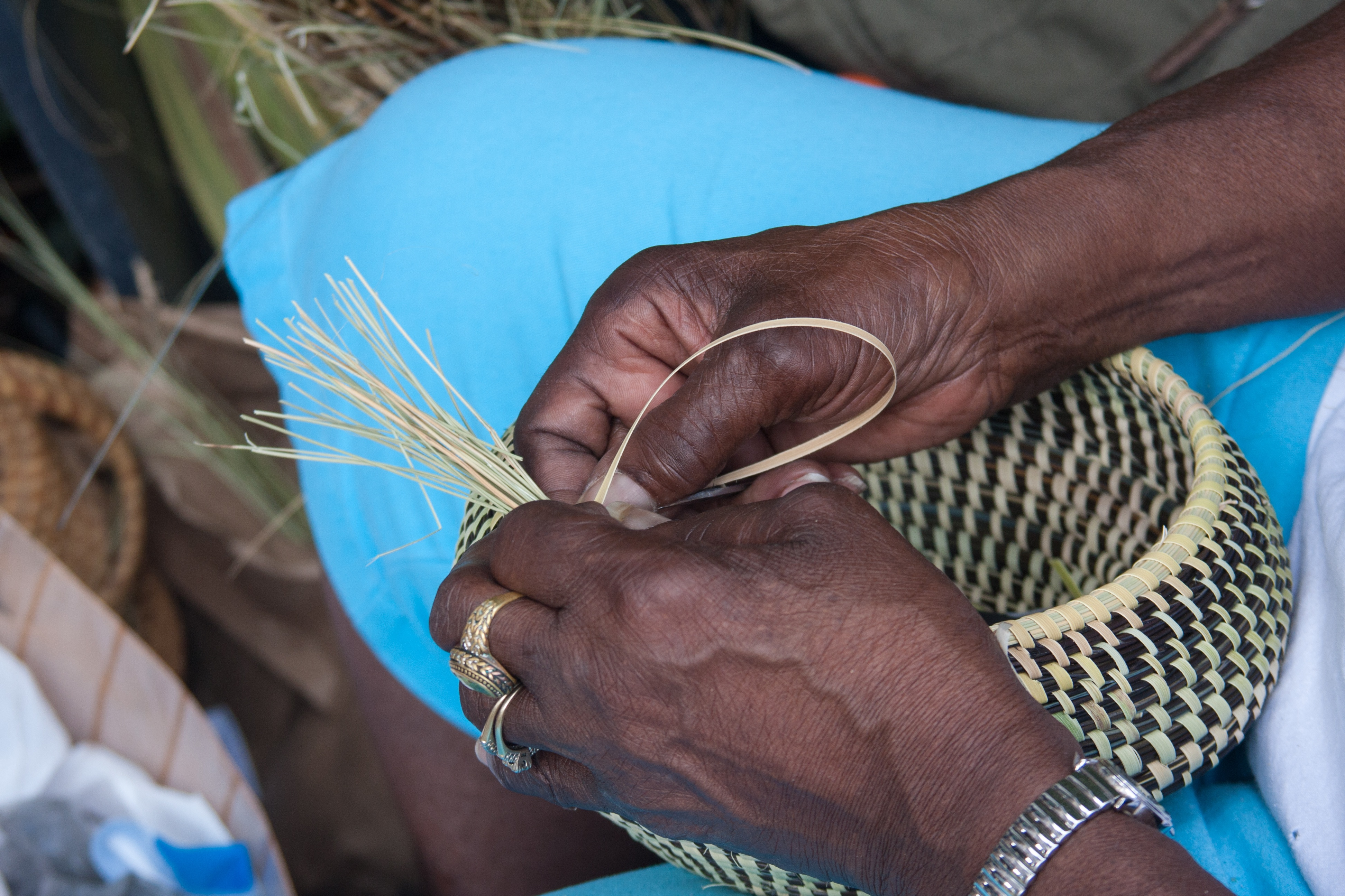 bigstock-Gullah-Basket-Weaving-45028168.jpg