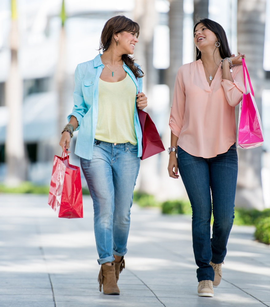Beautiful women on a shopping spree carrying bags.jpeg