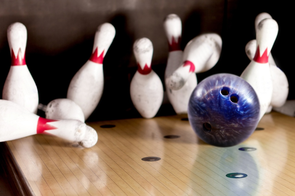 Bowling strike - ball hitting pins in the alley.jpeg