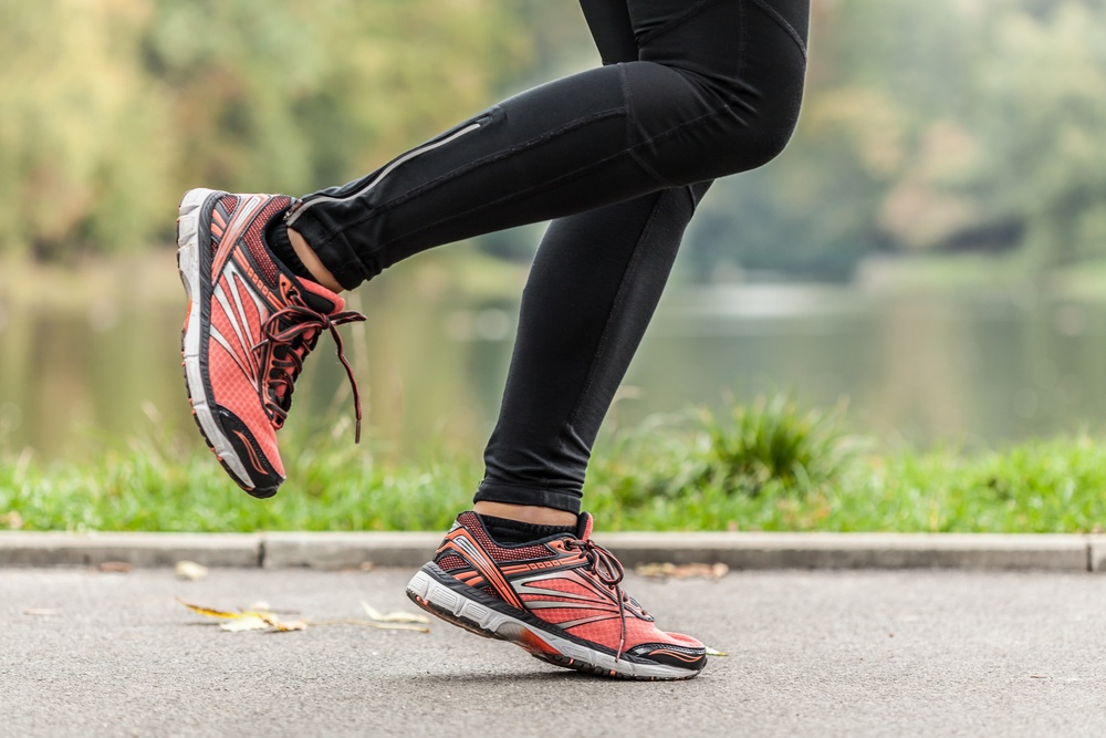 Close-up of young running in park woman's feet.jpeg