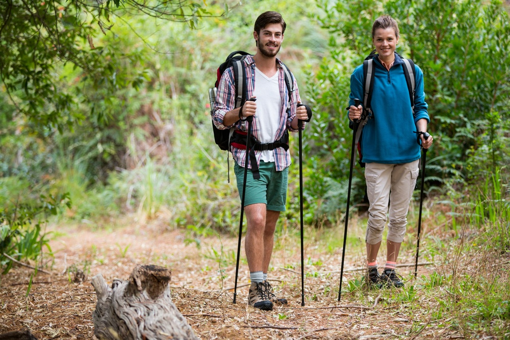 Couple hiking through a forest in the countryside.jpeg