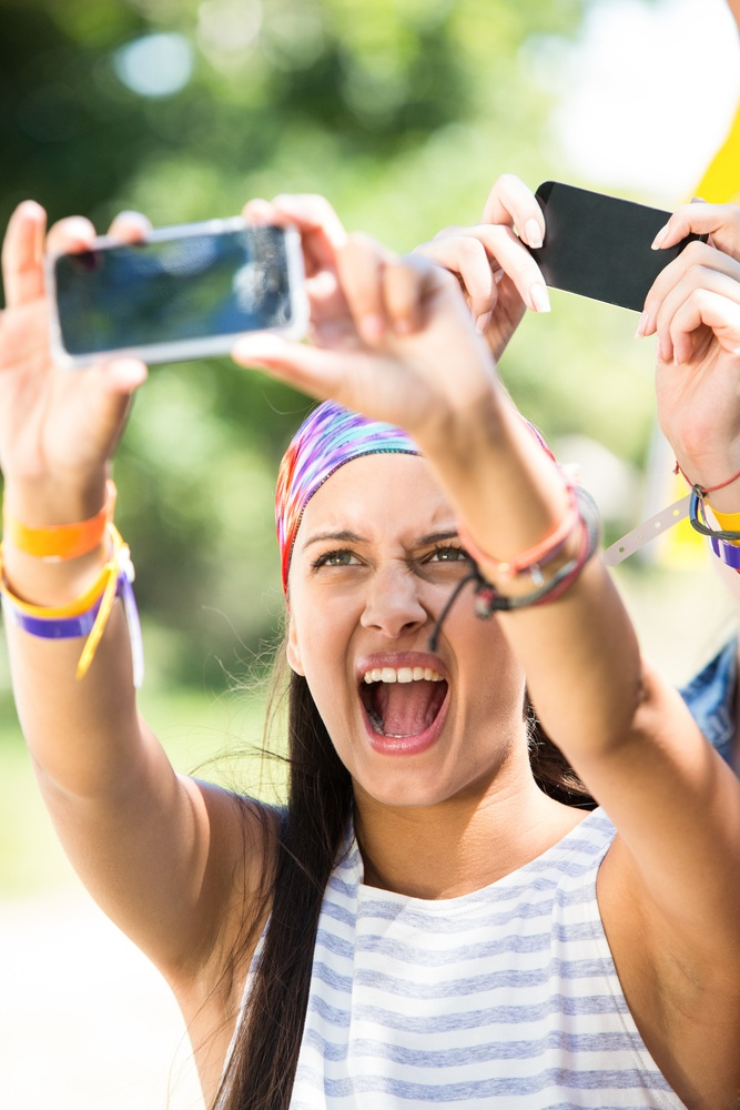 Excited music fan at festival on a summers day.jpeg