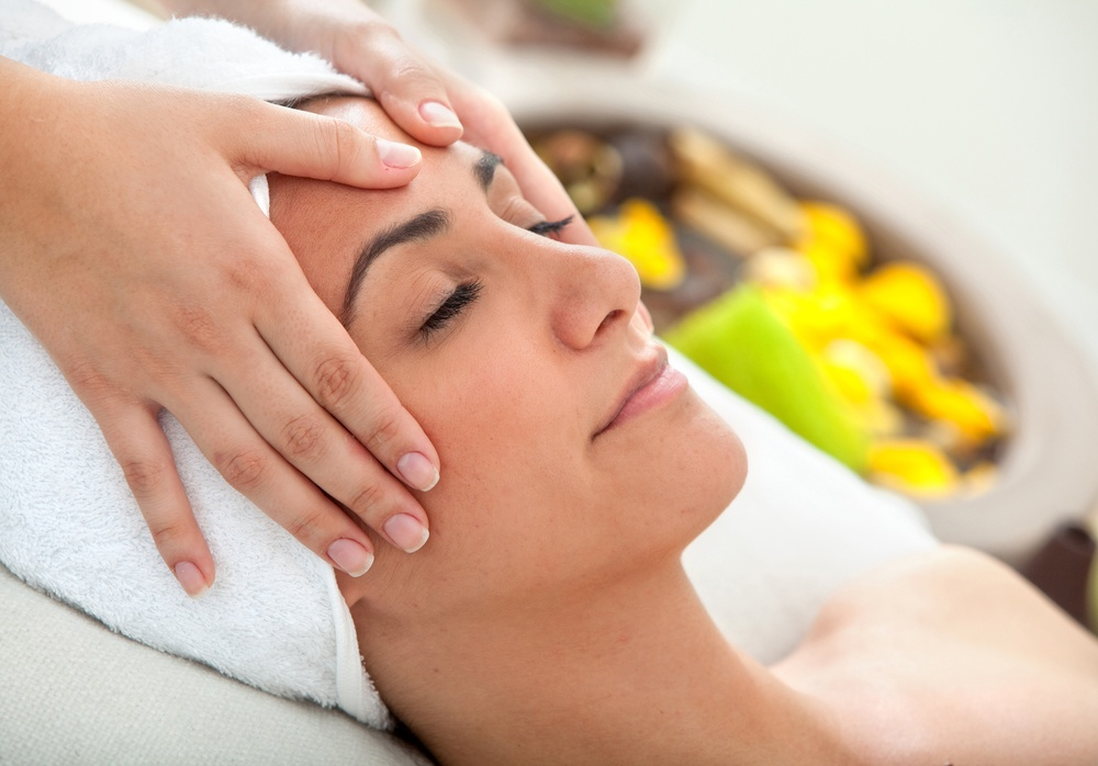Woman at a spa having a massage in her face.jpeg
